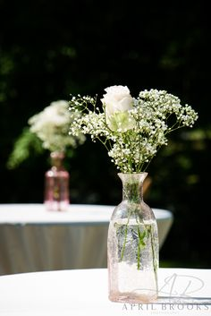 A single rose with a bit of baby's breath make for a beautifully simple table arrangement.