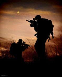Royal Marines from 43 Commando Fleet Protection Group are silhouetted during a training exercise near Glen Fruin, Argyll and Bute, Scotland....