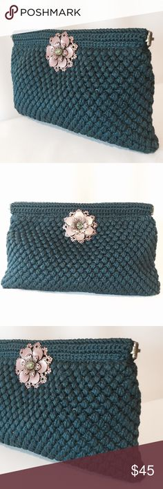 "☀️ Handmade Teal Crochet Clutch With Copper Flower One of a kind treasure! This amazing clutch is handmade, fully lined, has metallic copper flowers on both sides with beaded center. Featuring magnetic snap closure.   7"" H X 11"" W   100% poly  Spot clean only Bags Clutches & Wristlets"