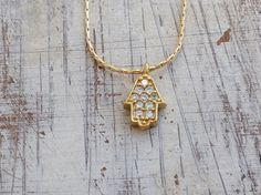 Check out this item in my Etsy shop https://www.etsy.com/listing/205643049/hamsa-necklace-hamsa-cubic-zirconia