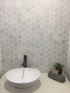 Love this simple backsplash using the Ames Roccia series hexagon mosaics www.amestile.com/roccia Bathroom Tile Designs, Bathroom Floor Tiles, Bathroom Toilets, Downstairs Bathroom, Laundry In Bathroom, Bathroom Renos, Small Bathroom, Bathrooms, Bad Inspiration