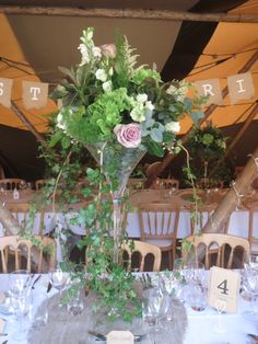 Vintage martini vase arrangement #centrepiece #vintagewedding