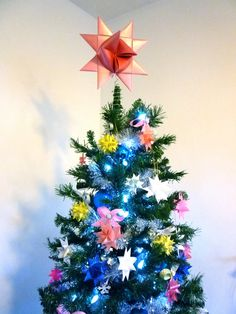 9 Christmas Tree Topper Rose Origami Star by theStarcraft on Etsy, $13.99