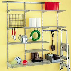 The Elfa shelving system from Container Store affixes to wall studs, and can bear the weight of heavier objects or be rearranged easily. Just be sure the track is level so that the standards hang straight; they're best for garage walls that are finished and plumb.