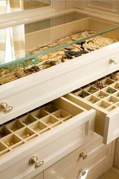 create a custom jewelry display-style case from an old dresser by removing the top & replacing with glass, and fill the top two drawers with organizers