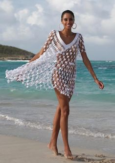 This open knit floral mini dress is a show-stopper whether you& wearing it.Madonna White V-Neck Crochet Mini DressWhite Spaghetti Strap Deep V Back Sleeveless Lace Crochet Maxi Dress Pull Crochet, Crochet Cover Up, Crochet Lace, Crocheted Flowers, Crochet Beach Dress, Crochet Bathing Suits, Crochet Bikini, Diy Dress, Crochet Clothes