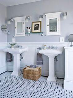 elegant gray bathroom with beautiful basket-weave tile floor.