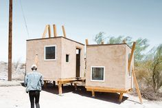 a forest of columns suspends the kerplunk house over the californian desert, by i stiffen thee