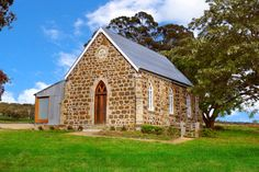 Laggan, Australia.  Decommissioned in 1943, this charming stone church in a eucalyptus grove underwent an initial conversion that was a lot less glamorous; it was used as a sheep's barn for over 50 years. When architect Michael Sandberg feasted his eyes on it, he saw the light. Now the building serves as his dreamy weekend getaway.