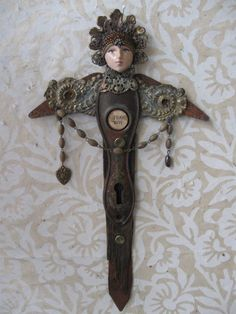 FEAR NOT ... vintage repurposed salvage angel assemblage art. $110.00, via Etsy.