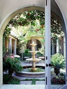 A pretty tiered fountain makes a stunning focal point on this relaxing patio. Wish I had a courtyard. Outdoor Rooms, Outdoor Gardens, Outdoor Living, Diy Garden Fountains, Outdoor Fountains, Water Fountains, Garden Statues, Water Features In The Garden, Spanish Style
