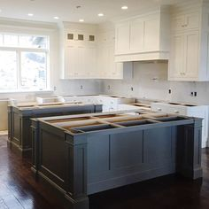 """""""Double islands happening at our #mountainsideremodel!  {cabinets are Benjamin Moore """"Swiss Coffee"""" and """"Chelsea Gray""""}"""""""