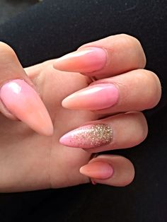 Orange and pink ombré stiletto nails with gold glitter