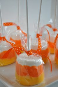 candy melts in orange and yellow  Campfire marshmallows (the bigger the better!) lollipop sticks (also from Michael's) Crisco To make:  microwave candy melts according to package directions.  Add a tablespoon of shortening to the melts to make the candy more smooth for dipping.  Stick a lollipop stick in the marshmallow, then dip 2/3 the way up the sides in orange.  Let cool and harden completely, then dip the bottom 1/3 of the marshmallow in the yellow candy melt.