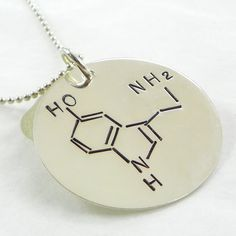I WANT THIS SOOO BAD!!!  Serotonin Molecule hand stamped sterling silver necklace. $50.00, via Etsy.