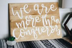 More Than Conquerors Handlettered Wood Sign by BlankPageLettering