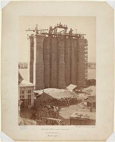 Brooklyn tower of the Brooklyn Bridge, completed to the roadway, September, 1872. Photo by Silas A. Holmes. From the Museum of the City of New York.