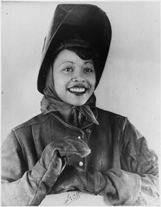 """Caption on back reads: """"Miss Gladys Theus, one of the fastest and most efficient welders at the Kaiser Company Permanente Metals Corporation yards near Oakland, Calif., is sticking to her job until final victory is won.  A native of Pueblo, Col., she has been employed in the shipyard for the last two years.  She says: 'Everytime I put in one more day on a ship, I know we are moving one day closer to V-E and V-J Days.'""""  - From the Roosevelt Presidential Library and Museum"""