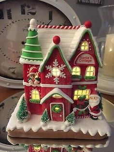 Illuminated Gingerbread Santa's Cottage by Valerie Parr Hill Gingerbread House Designs, Christmas Gingerbread House, Christmas Houses, Gingerbread Houses, Christmas Love, Christmas Candy, Christmas Crafts, Christmas Decorations, Xmas