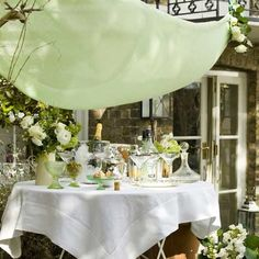 Set your table for outdoor serving - don't you just want to have a mixed drink in one of those lovely glasses? What a setting!