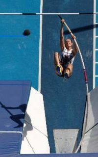 Britain's Holly Bradshaw competes in a qualifying round of the pole vault during the athletics