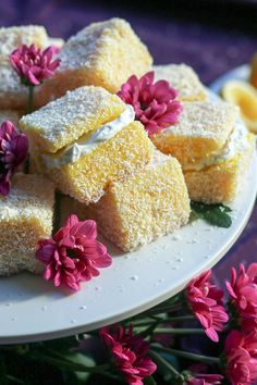 """ginger-in-the-kitchen: """" Lemon Lamingtons - Soft, delicious sponge covered in tangy lemon icing and coconut. Our twist on the traditional Kiwi & Aussie snack – Lemon Lamingtons. Lemon Recipes, Sweet Recipes, Baking Recipes, Dessert Recipes, Tart Recipes, Dessert Ideas, Dairy Free Snacks, Dairy Free Recipes, Lemon Icing"""