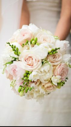 Peonies roses and freesia bouquet