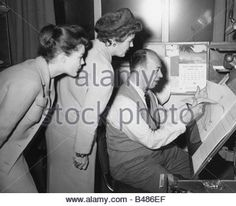 Schneider, Romy, 23.9.1938 - 29.5.1982, German actress, half length, with mother Magda Schneider and a cartoonist - Stock Photo