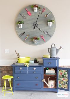 Pretty and Organized Garage at Chic Chateau. Awesome #repurposed potting bench and garden clock.