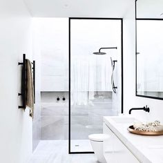 Still so in love with this bathroom I helped @cannygroup create. KWD's Italian porcelain is the perfect backdrop for this edgy bathroom, where details like the skylight above the shower and the full length niche work so well to create a minimalist yet well considered design.