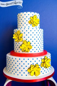 blue polka dot with yellow flowers cake