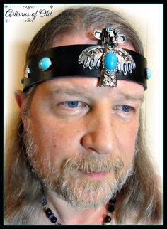 Native American looking 1.5 inch wide black leather headband has ornate antique silver and turquoise tribal inspiredcenterpiece. Sides have silver arrowheads and turquoise magnesite cabs in 2 sizes. All findings are hand wired into the band and back wiring is covered with felt for your comfort. Closes with leather ties. Fits 21 - 25 inches. >>>One of a kind.<<<