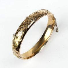 Cordy's / JEWELLERY, ANTIQUE AND ART AUCTION - / A vintage rose gold half hinged bangle / Lot A vintage rose gold half hinged bangle the top with engraved belt decoration, buckle absent, hallmarked Chester Art Auction, Chester, Bangle Bracelets, Bottles, Mad, Stamps, Coins, Rings For Men, Wedding Rings