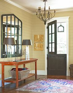 Pumpkin-colored antique table (originally used for shucking oysters). Mirror made from old window. - Traditional Home