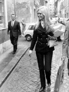 Brigitte Bardot in a drainpipe trouser suit and tie, 1960s