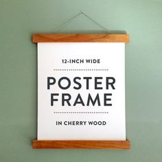 This cherry wood poster frame holds your print with super strong magnets that have been installed inside the wood so no screws can dent, bend,