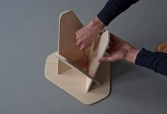 technical detail : a triangle part is fixated to keep the 3 pieces together / Wedge Table by Andreas Kowalewski