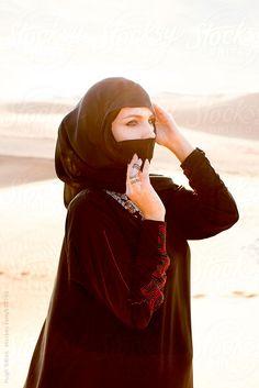 "traditional hijab, ""Hugh Sitton for Stocksy United"""
