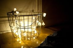 love this upcycled wire basket with a string of lights