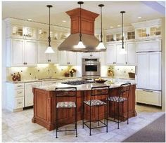 Shape of island; pendants; white cabinets w/tops and molding