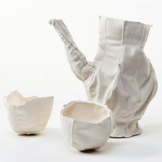 The cloth burns away when fired, leaving the delicate ceramic vessels behind.