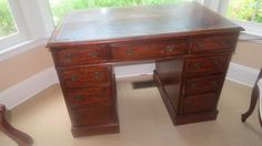 Antique English Mahogany tooled leather top(as is) knee hole desk.