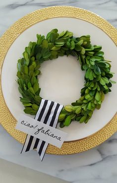 I love the look of a classic and bold striped ribbon. It has many uses besides wrapping around a gift box. Use it to hang a wreath, in a table setting and to keep collections together!