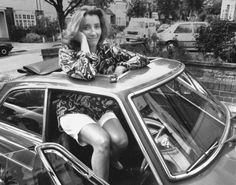 An excellent taste in cars: Emma Thompson popping up through the sunroof of her 1969 MGB, Aug. 14, 1991.