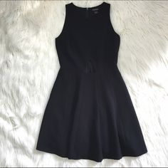 """Club Monaco Cutout Dress This dress is super flattering because of the fit and flare shape. Triangle cutout at waist. Nice quality thick material. Some wear on front and mark on back (see last photo) but overall good condition. Underarm to underarm: 17"""". Top of shoulders to bottom: 35"""". Around front of waist: 14"""""""".  65% polyester, 30% viscose, 5% elastane. make an offer! Club Monaco Dresses Mini"""