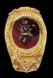 A ROMAN GOLD AND GARNET FINGER RING  CIRCA 2ND CENTURY A.D.- love the bee carving in garnet! and the granulation resembles pollen.
