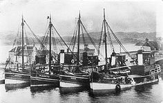 """Puffers """"Anzac"""", """"Pibroch"""", """"Moor"""" and """"Glenrosa"""" tied up at Crinan Canal basin"""