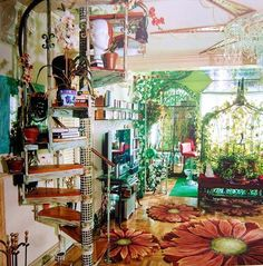 Very boho eclectic living space, spiral staircase, large painted flowers on floor photo