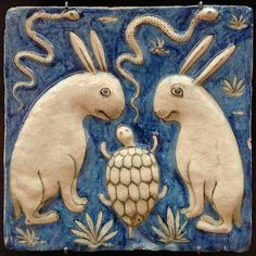 Tile artwork from ye olde Iran. Snakes! Rabbits! And a tortoise! (Looks like assassin snakes, ninja turtle, and two rabbit victims. The turtle leaps off the wall to eat the plants while the snakes leap off the wall to kill the rabbits.)