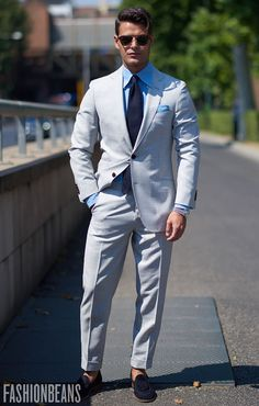 Light grey suit with contrast blue and navy perfect sprezzatura for summer